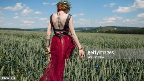 Woman with flower walking in the field