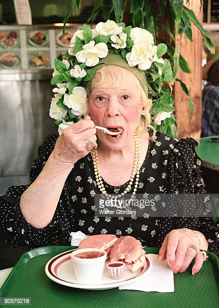 Woman with flowered hat eating