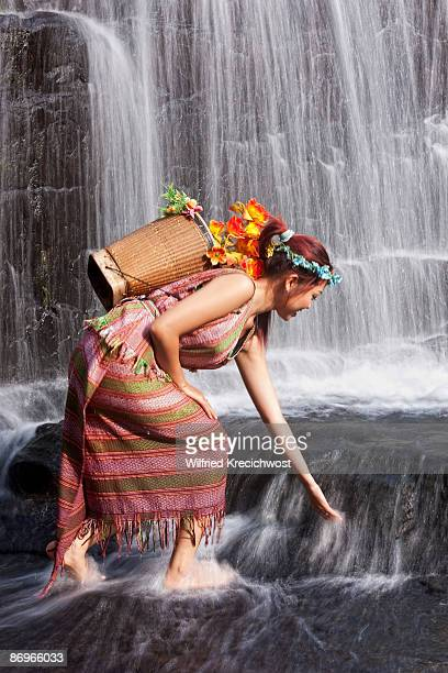 woman with flowers at Pongour Waterfall