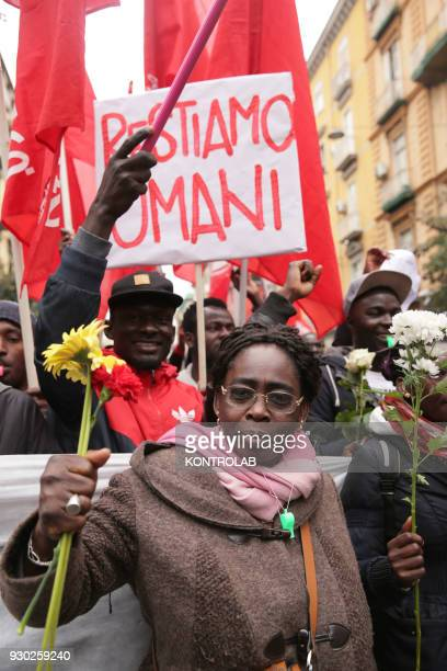 A woman with flowers during the demonstration that took place in Naples against racism and for Idy Diene a Senegalese street vendor killed in Florence