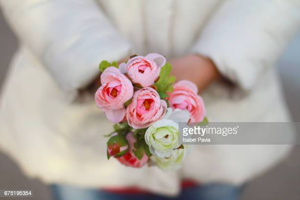 Woman with flowers on hands