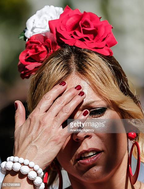 A woman with flowers on her head at the 'Feria de Abril 2016' the traditional Seville's Fair with 169 years of history on April 14 Seville Spain The...