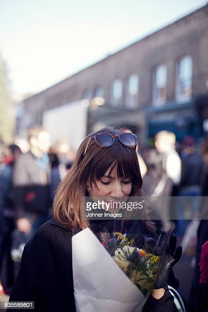Woman with flowers on street