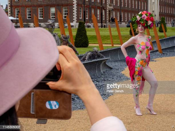 A woman with flowers painted on her body poses on press day at Chelsea Flower Show on May 20 2019 in London England The RHS Chelsea Flower Show takes...