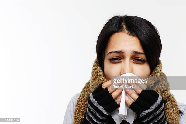 Woman with flu holding tissue
