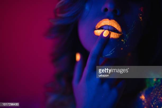 woman with fluorescent makeup - fluorescent light stock pictures, royalty-free photos & images
