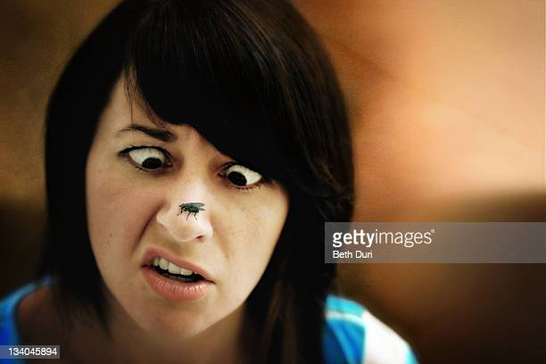 Woman with fly on nose