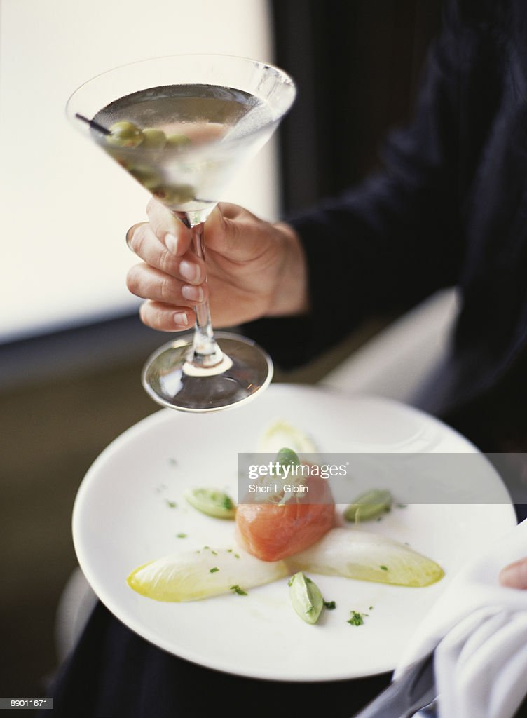 Woman with food and martini : Foto de stock