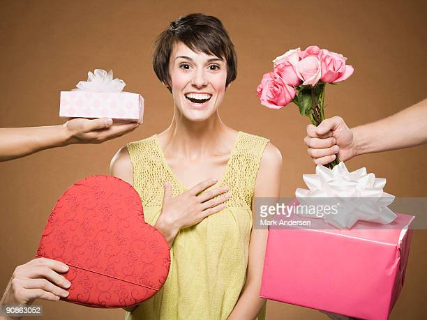 woman with four men giving presents - five people stock pictures, royalty-free photos & images