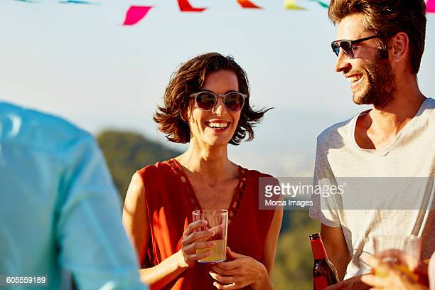 Woman with friends enjoying drink