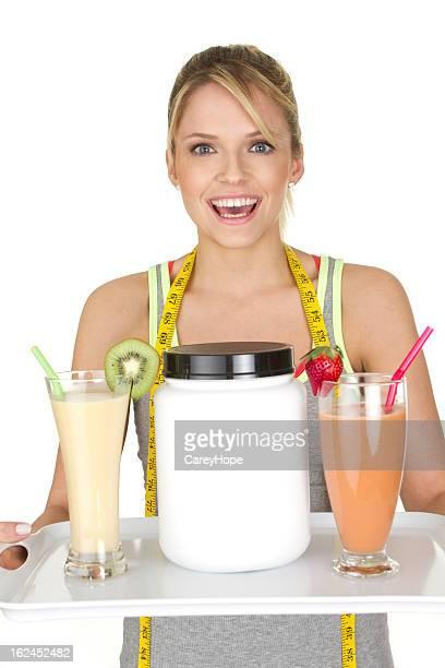 Mulher com frutas smoothies