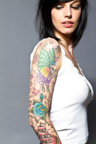 Woman with full-arm tattoos 153527847
