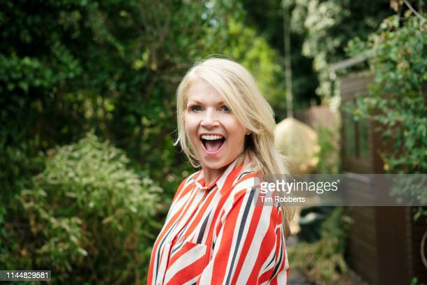 woman with fun laugh at camera - carefree stock pictures, royalty-free photos & images