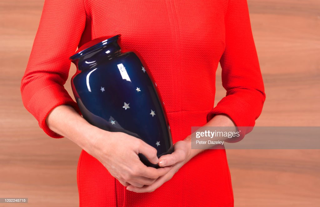 Woman with Funeral Urn : Stock Photo