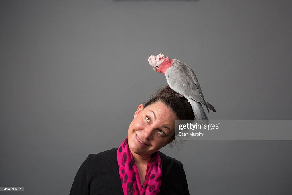 Woman with Galah Cockatoo on Head : Stock Photo