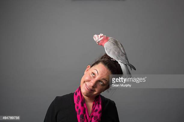 Woman with Galah Cockatoo on Head