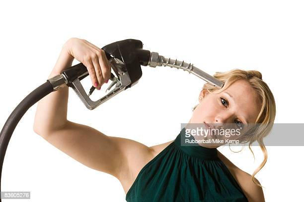 woman with gas pump to the head