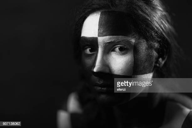 woman with geometric face painting - body paint stock pictures, royalty-free photos & images