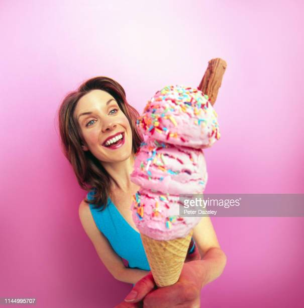 woman with giant ice cream - large stock pictures, royalty-free photos & images