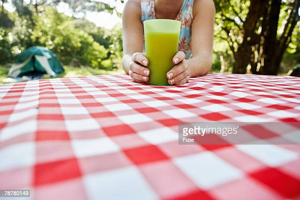 Woman with Glass of Orange Juice Outdoors