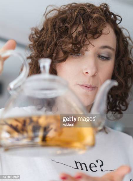 Woman with glass teapot