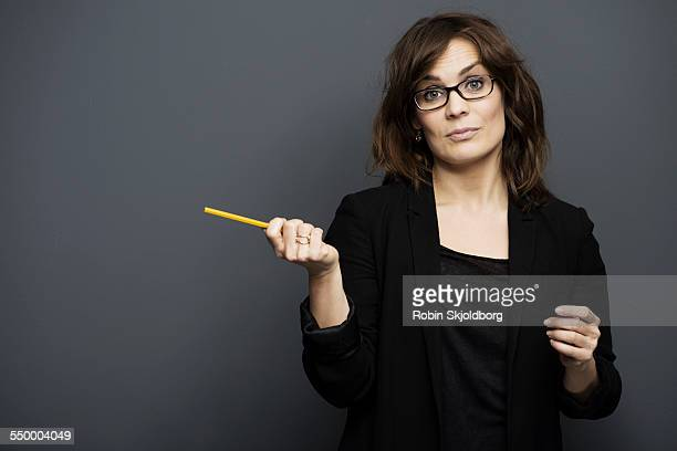 Woman with glasses holding pencil