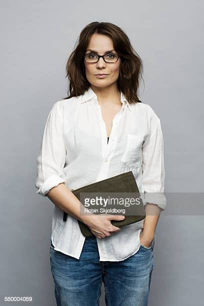 Woman with glasses holding purse