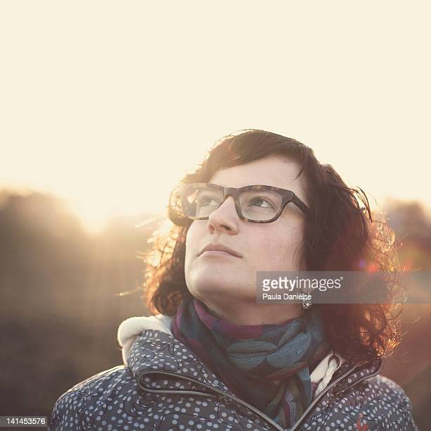 woman with glasses looking up - one mid adult woman only stock pictures, royalty-free photos & images