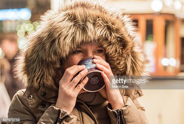 Woman with glogg at christmas market