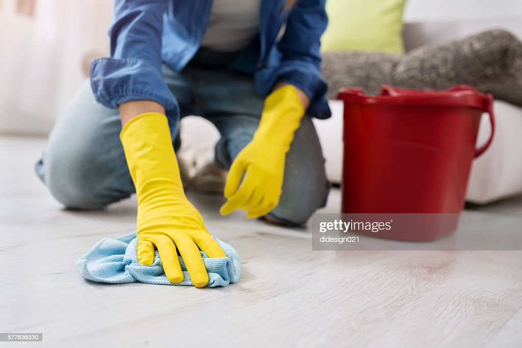 woman with gloves cleans the floor : Stock Photo