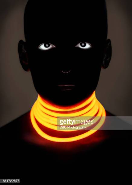 Woman with Glowing Neck Rings