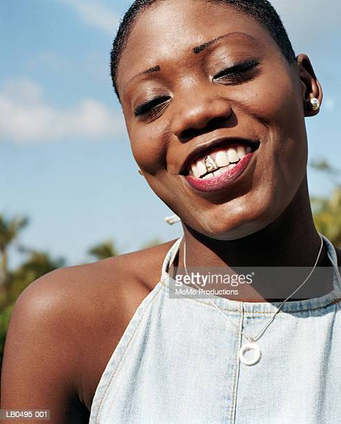 woman with gold tooth smiling, close-up, portrait - gold tooth stock photos and pictures