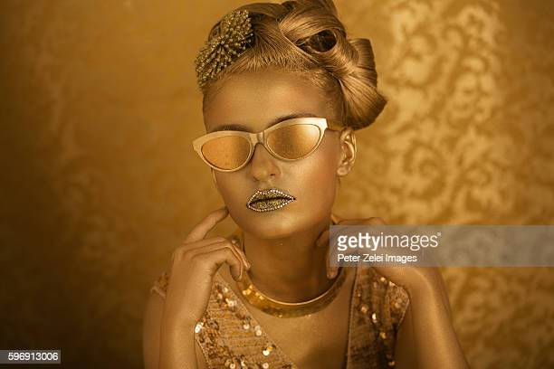 woman with golden body painting with golden eyeglasses - body paint stock pictures, royalty-free photos & images