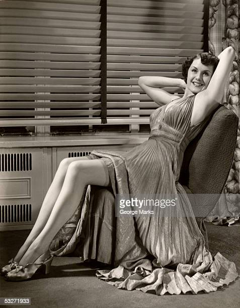 Woman with gown raised above nylon stocking legs