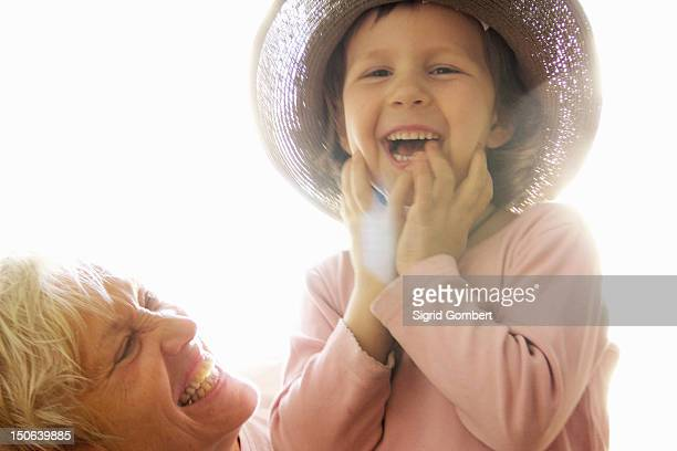 woman with granddaughter outdoors - sigrid gombert stock pictures, royalty-free photos & images
