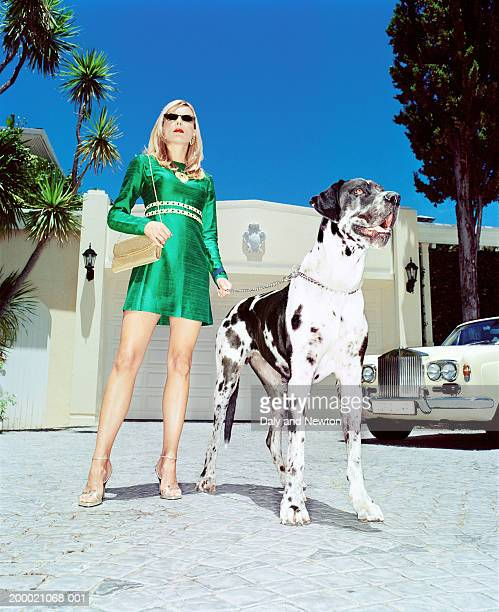 Woman with Great Dane on drive, low angle view