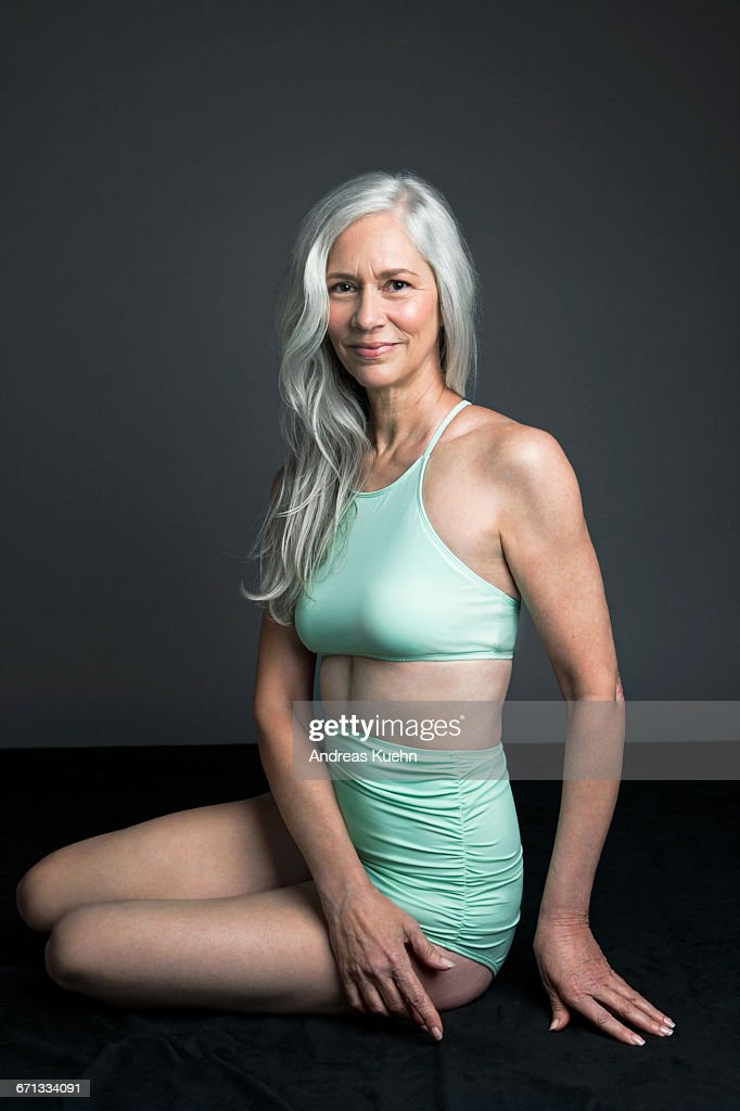 Woman With Grey Hair In A Two Piece Swimsuit ストックフォト