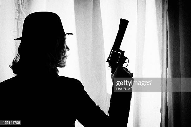 woman with gun.retro look.black and white. - film noir style stock pictures, royalty-free photos & images