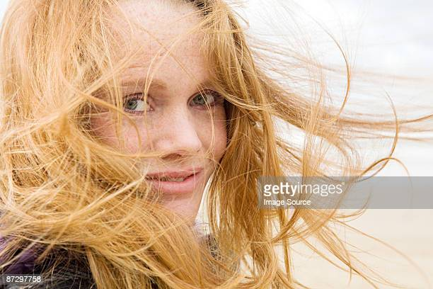 Woman with hair blowing in breeze