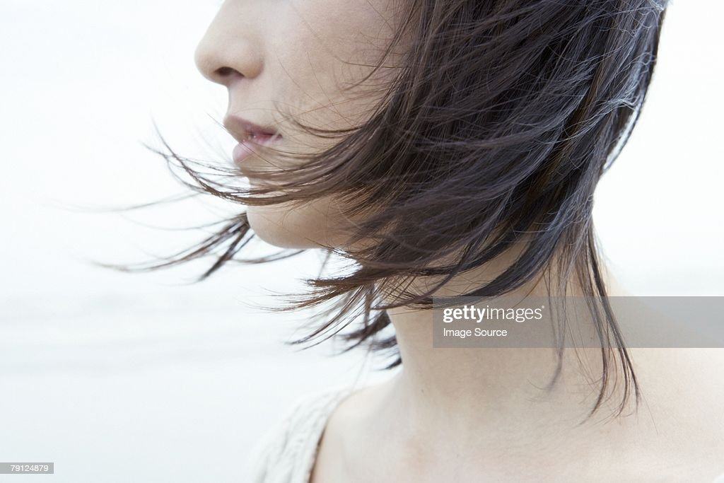 Woman with hair blowing in wind : Stock Photo