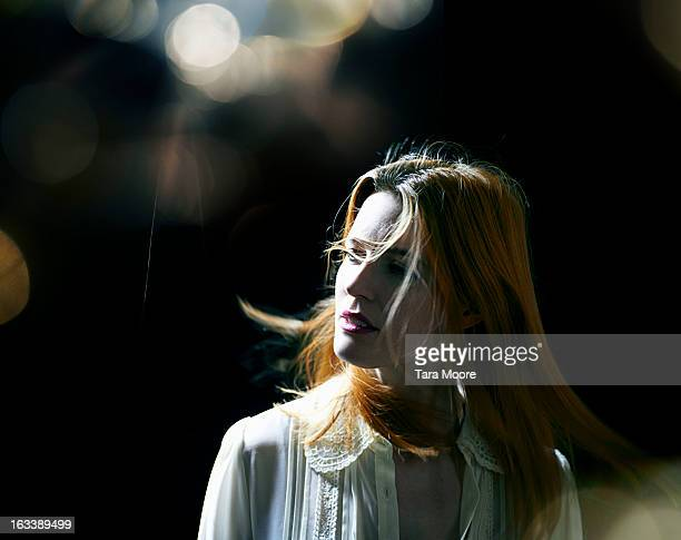 woman with hair blowing  with lens flare