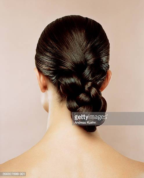 woman with hair braided, rear view - long hair stock pictures, royalty-free photos & images
