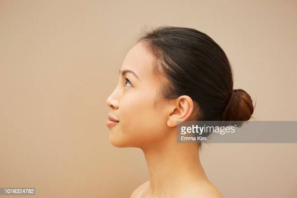woman with hair bun - side view stock pictures, royalty-free photos & images