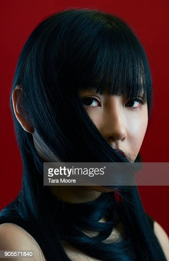 woman with hair covering mouth