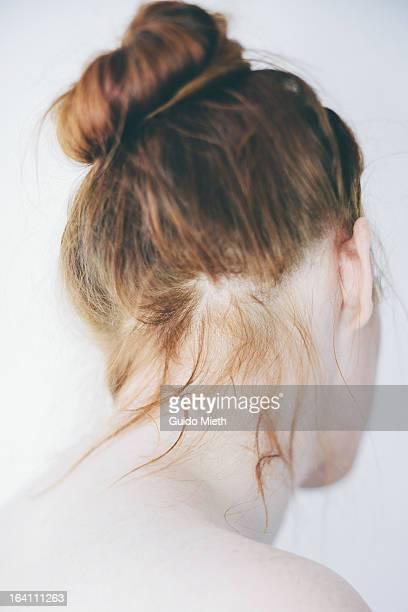 Woman with hair dutt.