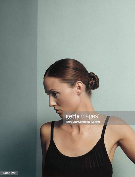 Woman with hair in bun, portrait