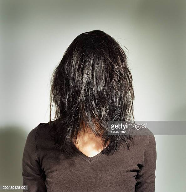 Woman with hair over face