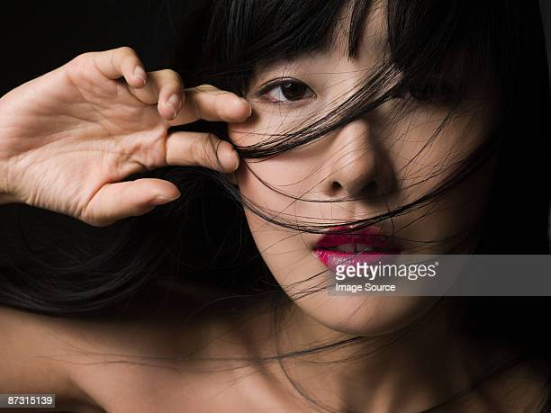 woman with hair over her face - asian model stock photos and pictures