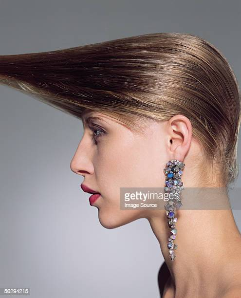 Woman with hair pulled forward