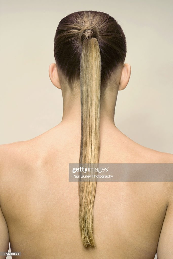 Woman With Hair Tied Back Stock Photo Getty Images